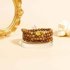 Vòng tay trầm hương 108 Hoa Sen vàng