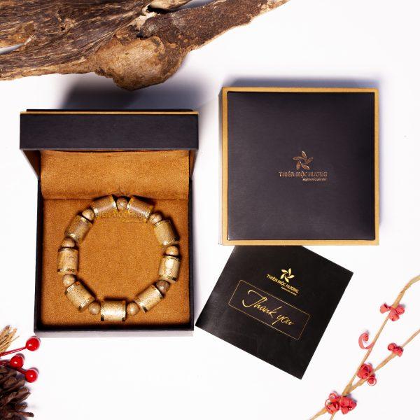 Vòng tay trầm hương Hoàng Kim Trụ bọc vàng
