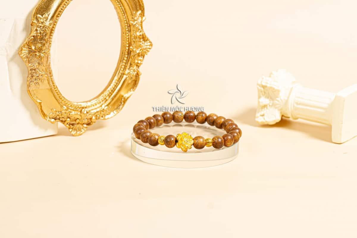 Vòng tay trầm hương Hoa Sen vàng đơn