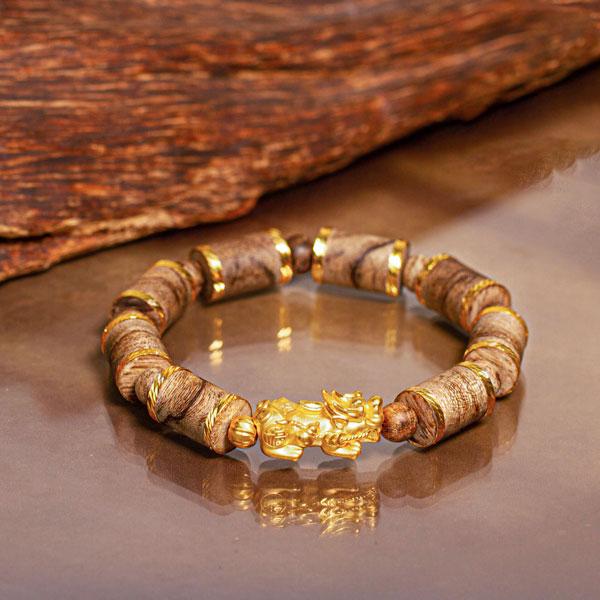 Vòng tay gỗ Trầm Hương trụ trúc Philippines bọc vàng Tỳ Hưu Vàng